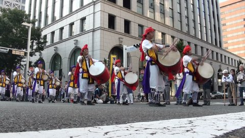 NAGOYA, JAPAN - 20 OCTOBER 2012: People dressed in traditional Japanese costumes go through the streets of Nagoya singing and dancing catchy songs