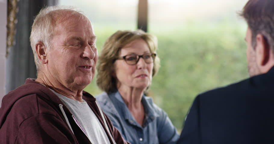 Attractive Senior Couple talking with Financial Advisor
