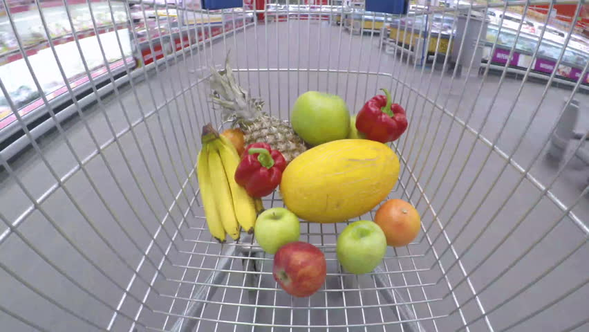 Shopping cart or trolley with fresh colorful vegetables and fruits moving through supermarket. Timelapse shot. Consumerism, sale and shopping concept | Shutterstock HD Video #32711656