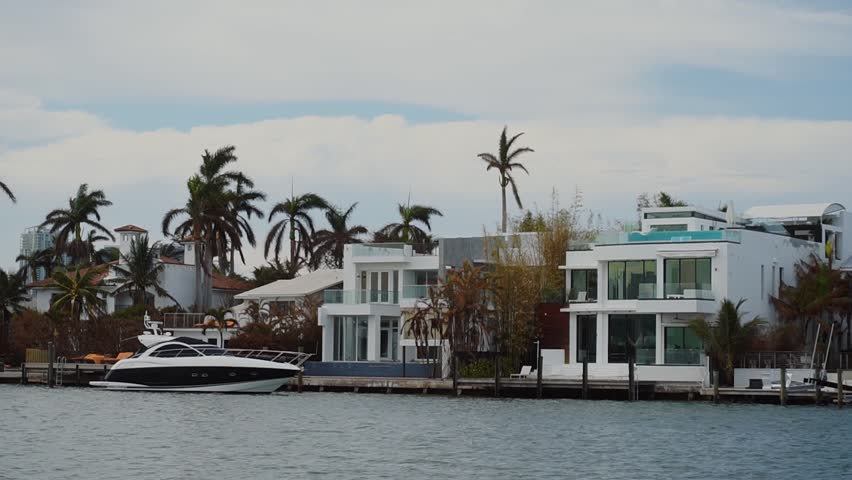 wonderful walking boat near luxurious mansion of wealthy people unde cloudy sky,sunny isles beach,miami