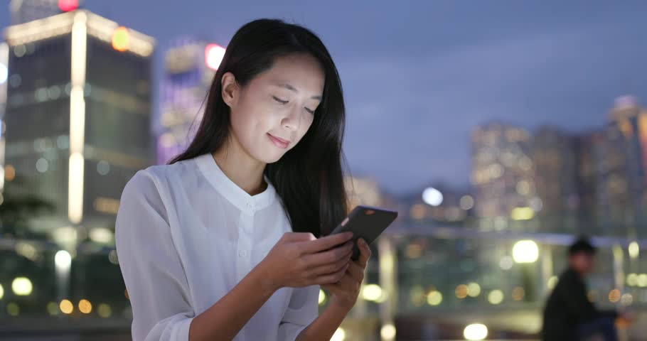 Business woman work on cellphone in city at night | Shutterstock HD Video #32737579