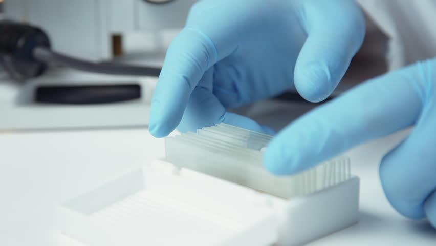 Close up crop shot of hands putting microscope glasses in box | Shutterstock HD Video #32740894