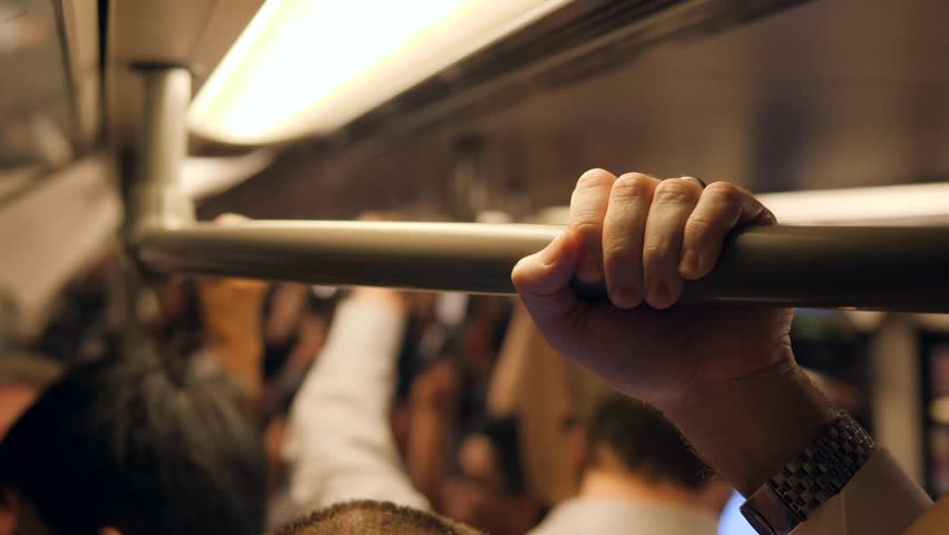 Business Man's Hand Holds on to the Rail Hanger in the Subway Train. 4K. Bangkok, Thailand.