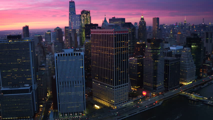 Aerial view above the East River. Famous Manhattan skyscrapers. Traffic passing by FDR Drive. Manhattan. United States, North America. Dusk. Shot from a helicopter. | Shutterstock HD Video #32798545
