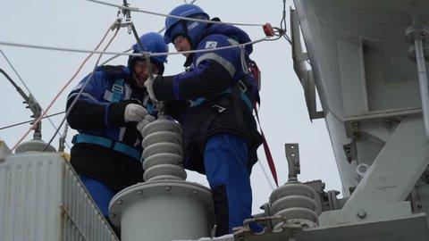 Electricians repair equipment