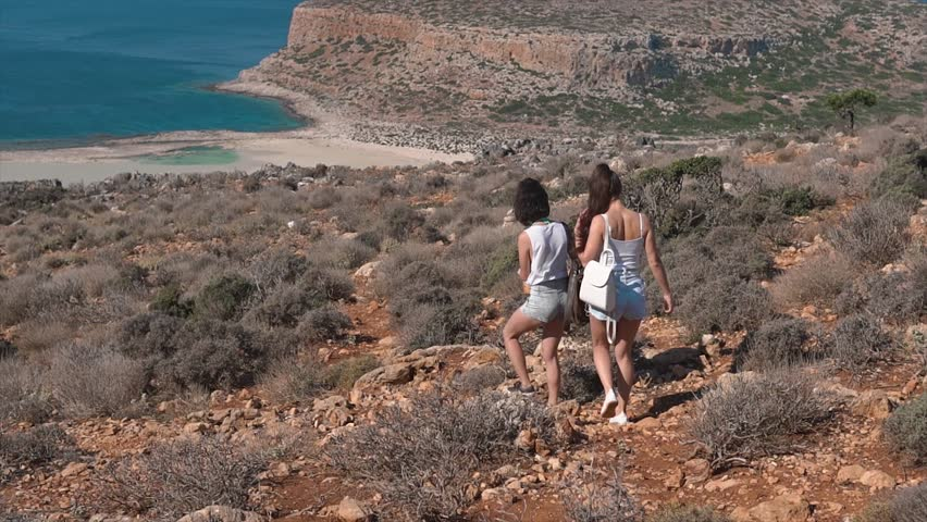 Two woman with trendy look searching direction on location map while traveling abroad in summer | Shutterstock HD Video #32817850