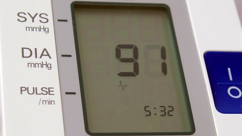 Device showing on display result of measuring blood pressure. It is showing symptoms of hypertension: high blood pressure and high pulse. 4K UltraHD video