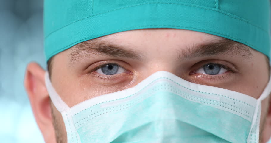 Macro Shot of Doctor Man Posing Serious Look Wearing Surgical Mask in Hospital | Shutterstock HD Video #32842609