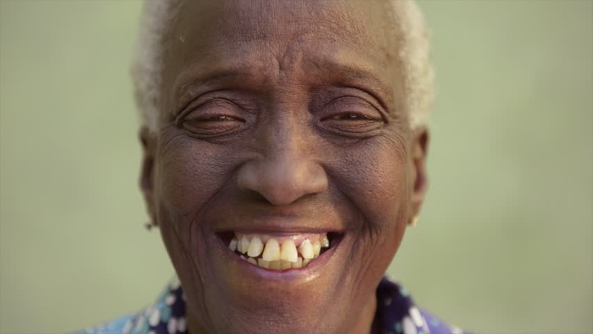 Old people and emotions, portrait of bizarre senior african american lady laughing and looking at camera