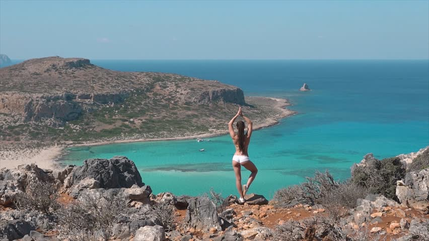 yoga woman doing pose at the ocean #32875159