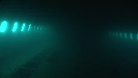 air plane wreck underwater scuba divers exploring