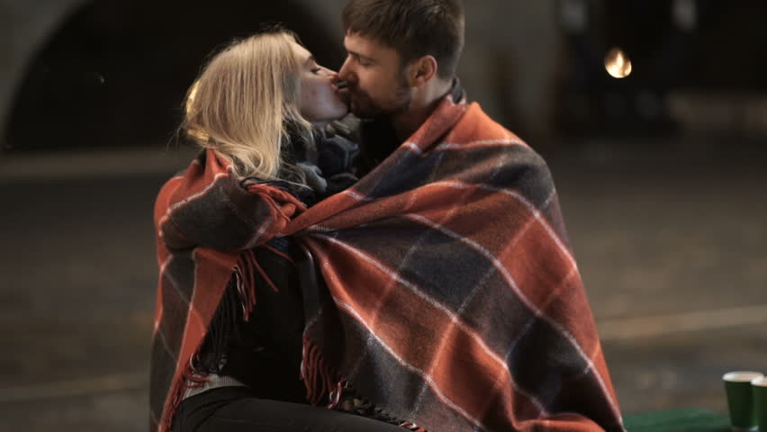 A young couple hug and kiss each other in a city Park at autumn cold night  | Shutterstock HD Video #32897380
