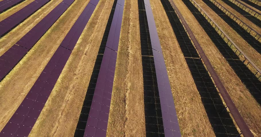 aerial view of solar station on agriculture, solar power plants, solar panels farm drone shooting