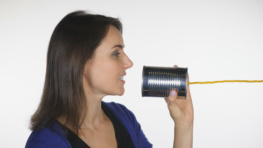 Attractive woman talks into tin can. Profile shot. Obsolete telephone communication.
