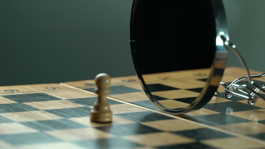 Black pawn white pawn on the chess board