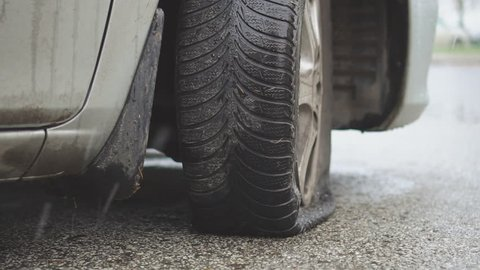 Close-up view of flat tire in winter.