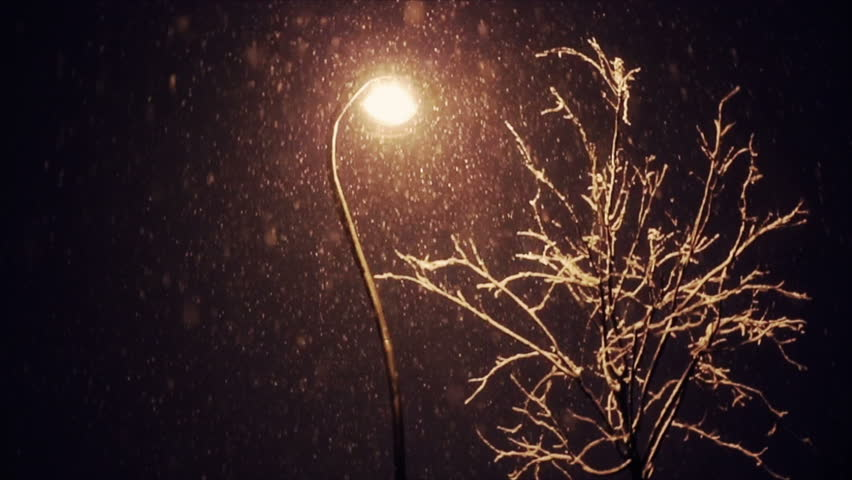 Lighted Lantern At Night And Snow Falls In The Square Winter