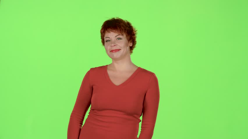 Woman advertises the products and shows a thumbs up. Green screen   Shutterstock HD Video #33029050