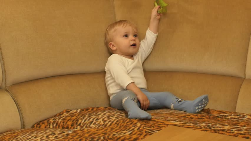 2f85ed75856e cute 9-10 months old baby boy calms down and freezes smooth zooming. A. De  Aleksej Artiuch