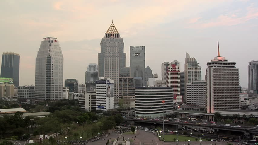 Skyline of Buildings in Silom and Sathon District with Lumphini Park Timelapse Day-to-Night | Shutterstock HD Video #3307829