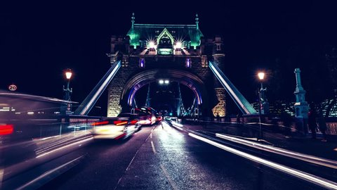 Timelapse of fast moving traffic at night on Tower Bridge London