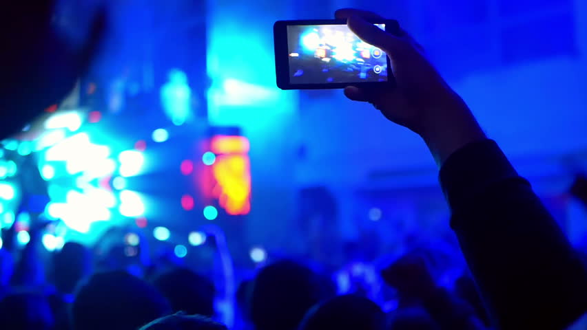 Music concert shooting video via cell phone camera of a concert   Shutterstock HD Video #33140389