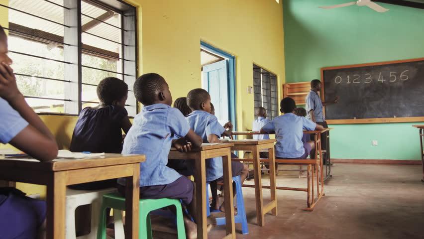 4k Of African Pupils Raising Hand In Class To Answer Teachers Mathematics Question