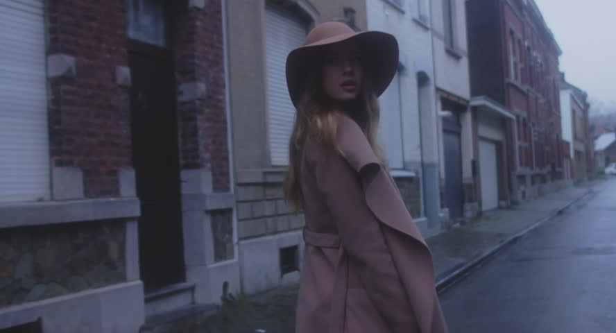 TRACKING SHOT Beautiful Caucasian female in stylish outfit walking in the streets of old European city, urban background. 4K UHD 60 FPS SLO MO   Shutterstock HD Video #33164179