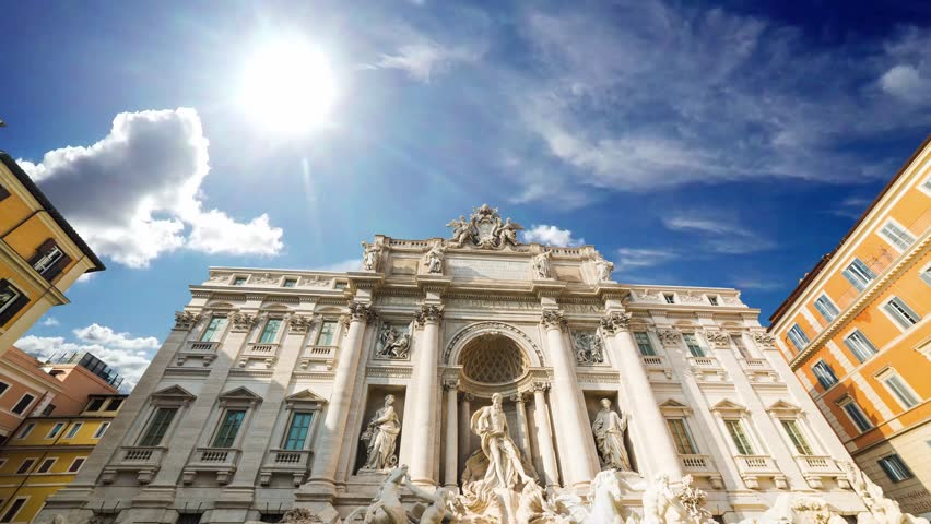 Clouds passing over world famous Fontana di Trevi in Rome, Italy. Time lapse effect