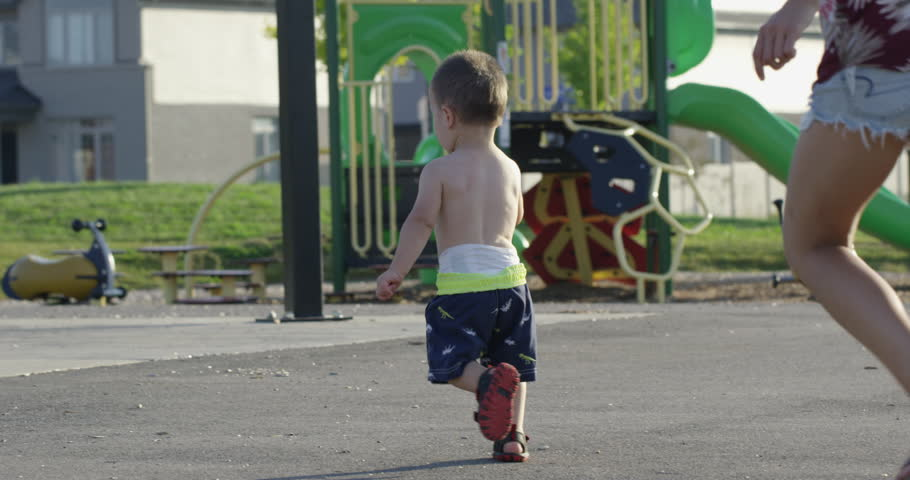Mother and Toddler running at park in summer   Shutterstock HD Video #33229009