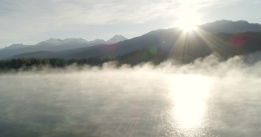 Aerial Panning Right Reveal Of Foggy Mountain Landscape At Sunrise | Shutterstock HD Video #33236359