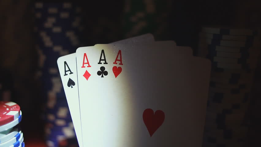 Four Aces On Poker Chips. Poker Table With Chips In Casino