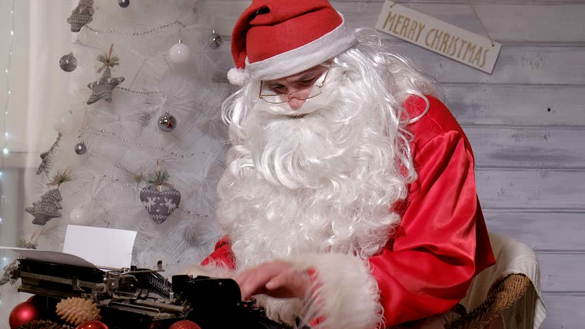 santa claus online shopping on a tablet stock footage video