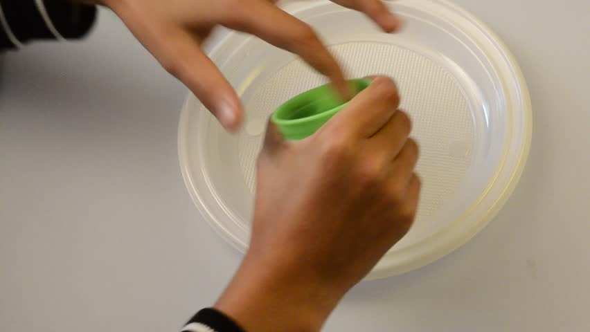 Green slime paste, child's hand playing