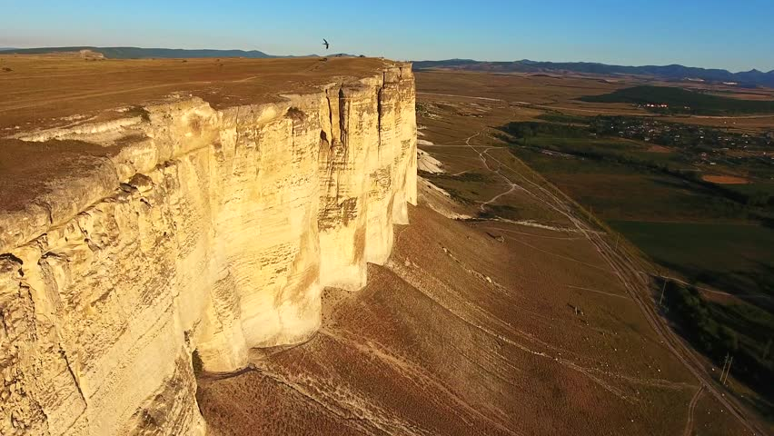 Top view: Rock Canyons Aerial flight going in between high rocks structures with a bird flying in front camera authentic view | Shutterstock HD Video #33383929