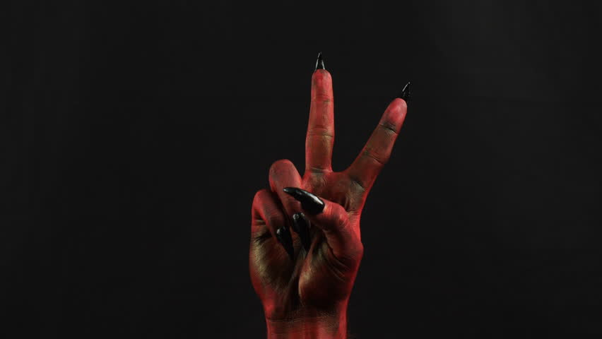 Peace gesture by devil hand. 50 fps | Shutterstock HD Video #33388519