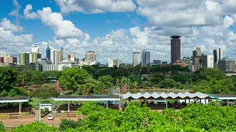 Nairobi city timelapse from above Uhuru Park. light clouds pass over the city. The Kenyatta International Convention Centre can be seen as well as other buildings in the city.