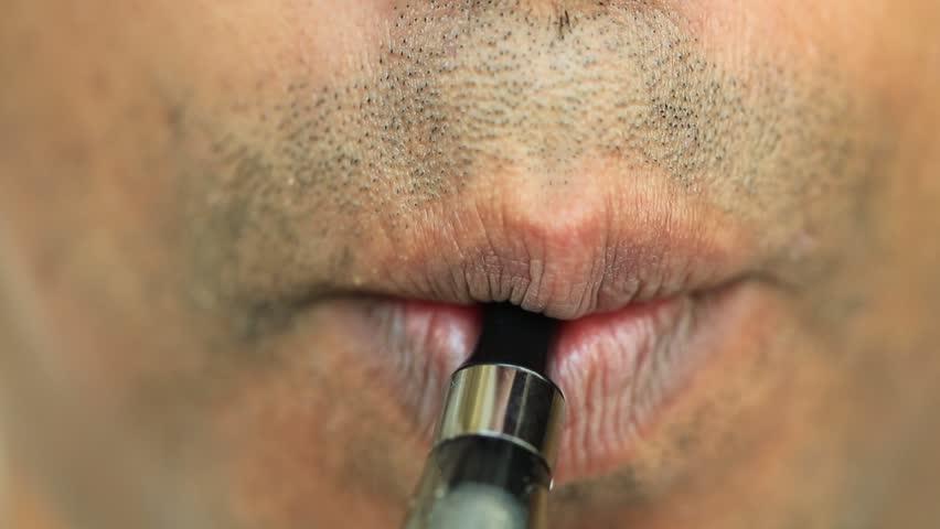 Young man smoking electric e cigarette    Shutterstock HD Video #33410929