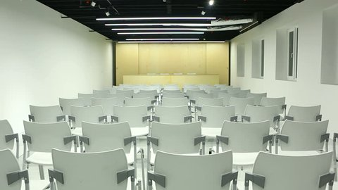 Empty conference hall with large number of seats slider shoot. Conference room for the business audience