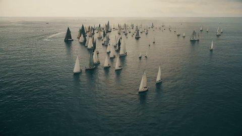 Sail boat sailing towards the Italian coast/Epic aerial shot showing sail boat sailing towards the Italian coast/Portofino, Italy