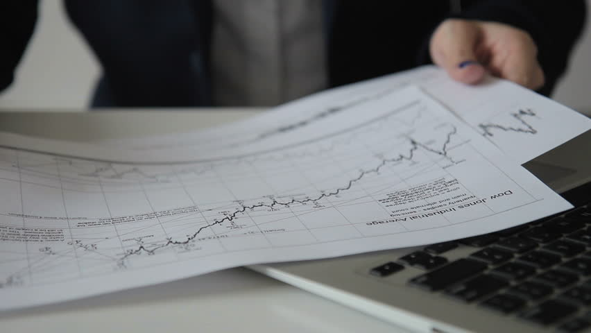Close-up woman writing a pen makes notes on chart on paper. Before woman there are documents with diagrams, which are analyzed at work. | Shutterstock HD Video #33481942