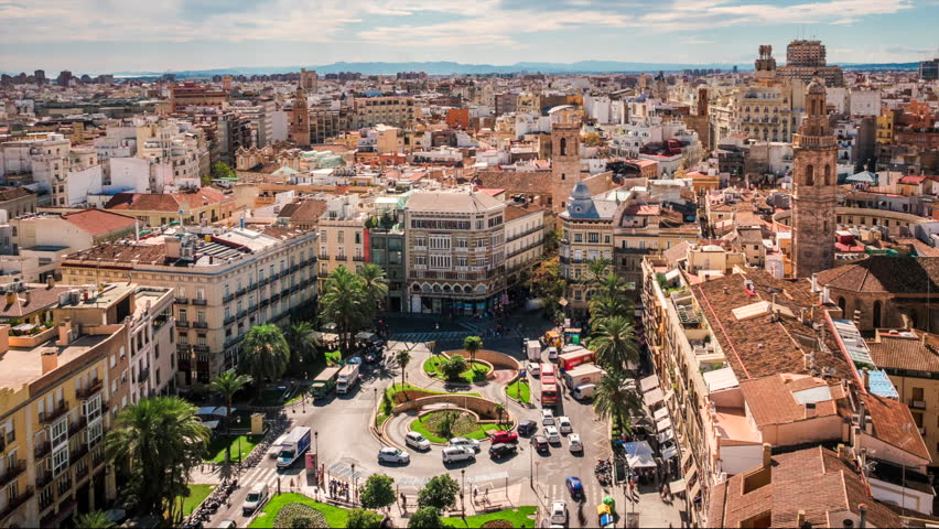 Valencia, Spain, time lapse view of traffic and people at Plaza de la Reina during daytime.