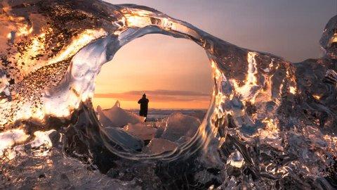 Iceland, Diamonds beach - creative idea 4K time lapse from iceberg hole to frozen ocean