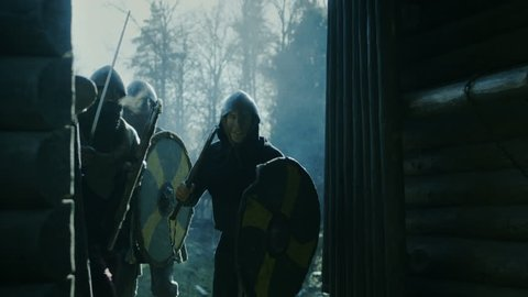 Large-Scale Medieval Battle Reenactment. Violent Tribe of Warriors Run Through The Gates of the Wooden Fortress and Attack Guards. They Fight with Axes, Swords and Shields.  Shot on RED EPIC-W 8K.