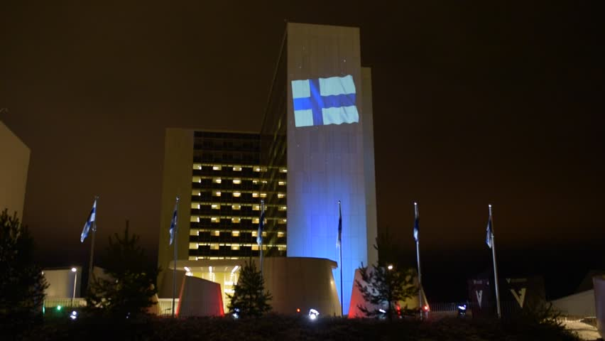 HELSINKI, FINLAND - DECEMBER 6, 2017: Meilahti Tower Hospital decorated in special blue and white color light and Finnish flag as part of the celebration of 100th anniversary of Finland's independence