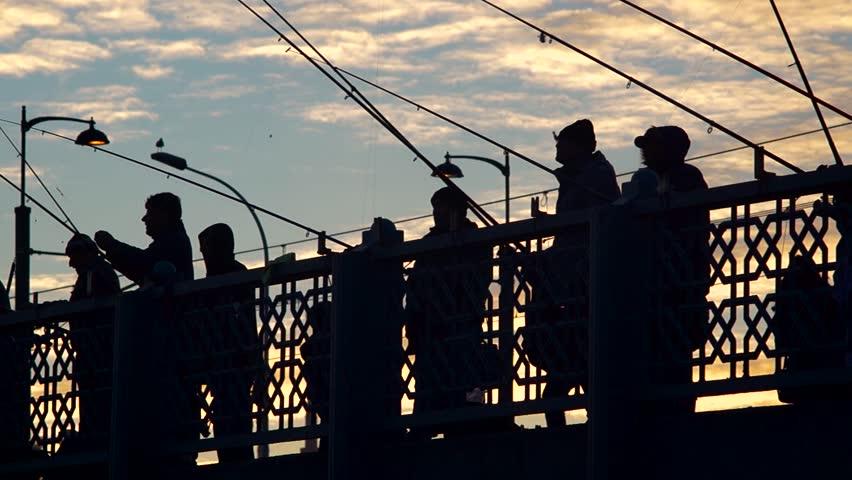 People Fishing On Top Of Galata Bridge, Istanbul, Turkey