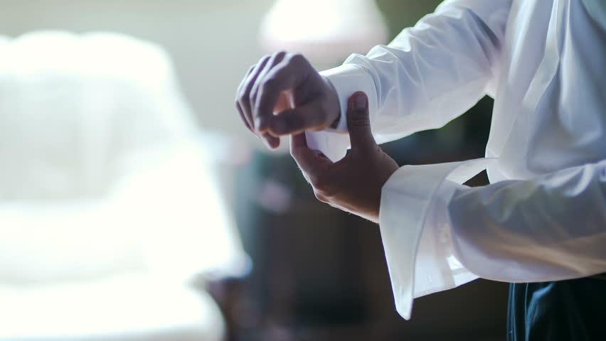 Man buttoning shirt closeup. Dressed man. Dressing up men's. Men hands.