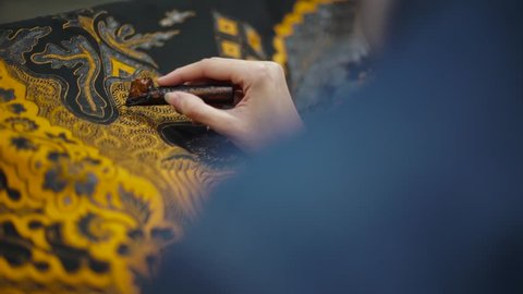 December 6 2017, Surakarta Indonesia: Woman drawing Batik on fabric with motif of culture Surakarta City