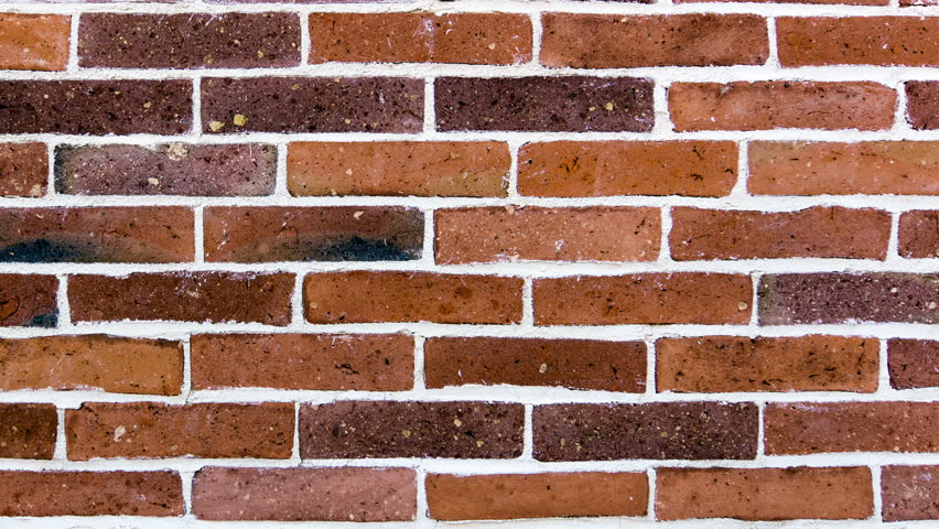 A new wall of old brick of different colors. Brick Wall Scrolling By