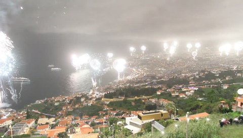 FUNCHAL, PORTUGAL - January 1, 2017: View of the start of fireworks of new year over Funchal City, Madeira island, Portugal.